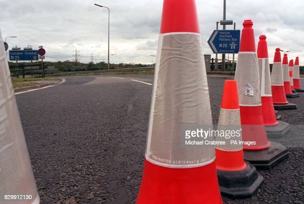 A slip road for junction 21 of the M25 near Hemel Hempstead Hertfordshire is conedoff as security alerts bring the rushhour traffic to a standstill...