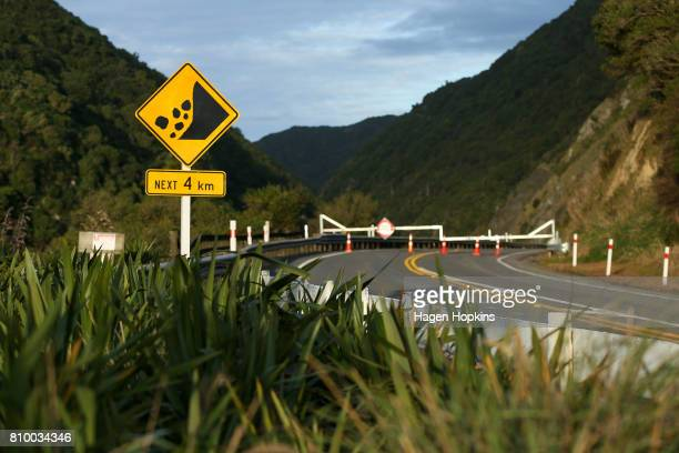 A slip warning road sign in front of a road closure at Manawatu Gorge on July 7 2017 in Palmerston North New Zealand The highway was closed on April...