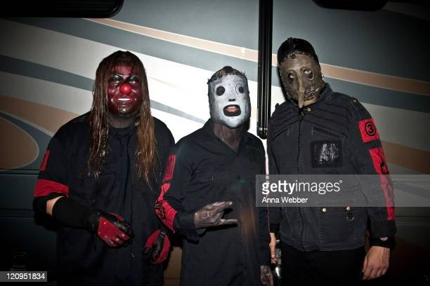 Slipknot's Shawn Crahan Corey Taylor and Chris Fehn pose backstage at Cypress Hill's Smokeout on October 24 2009 in San Bernardino California