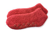 Red acrylic slipper socks isolated on white