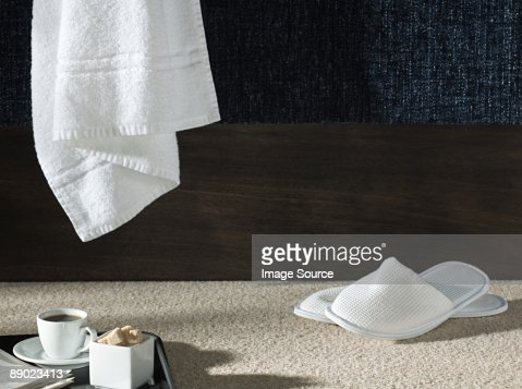 Slippers and a towel in a hotel room