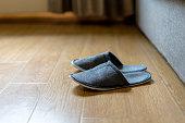slippers on floor beside sofa