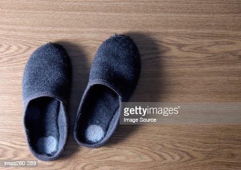 Slippers on wooden floor