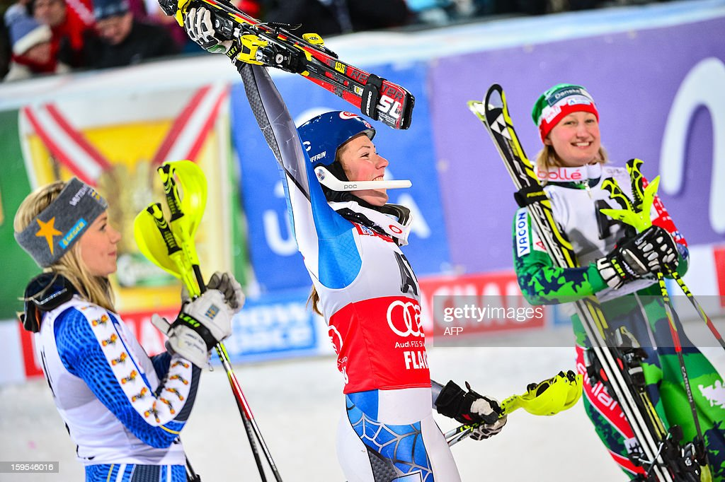 Sliver medalist Frida Hansdotter of Sweden, winner Mikaela Shiffrin of USA and bronze medalist Tanja Poutiainen of Finland react in finish area of of the FIS World Cup women's slalom in Flachau on January 15, 2013. AFP PHOTO / Jure Makovec
