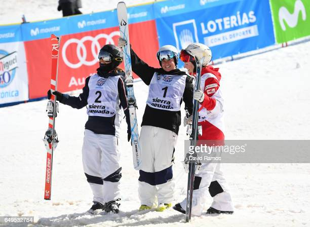 Sliver medalist Perrine Laffont of France gold medalist Britteny Cox of Australia and bronze medalist Justine DufourLapointe of Canada celebrate...