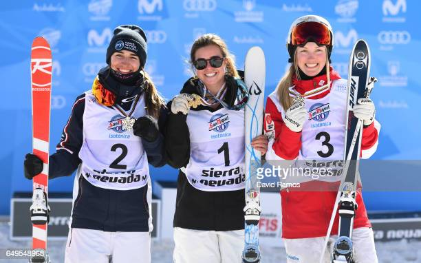 Sliver medalist Perrine Laffont of France gold medalist Britteny Cox of Australia and bronze medalist Justine DufourLapointe of Canada pose during...