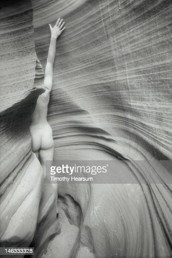 Sliver of female nude form in slot canyon : Stock Photo