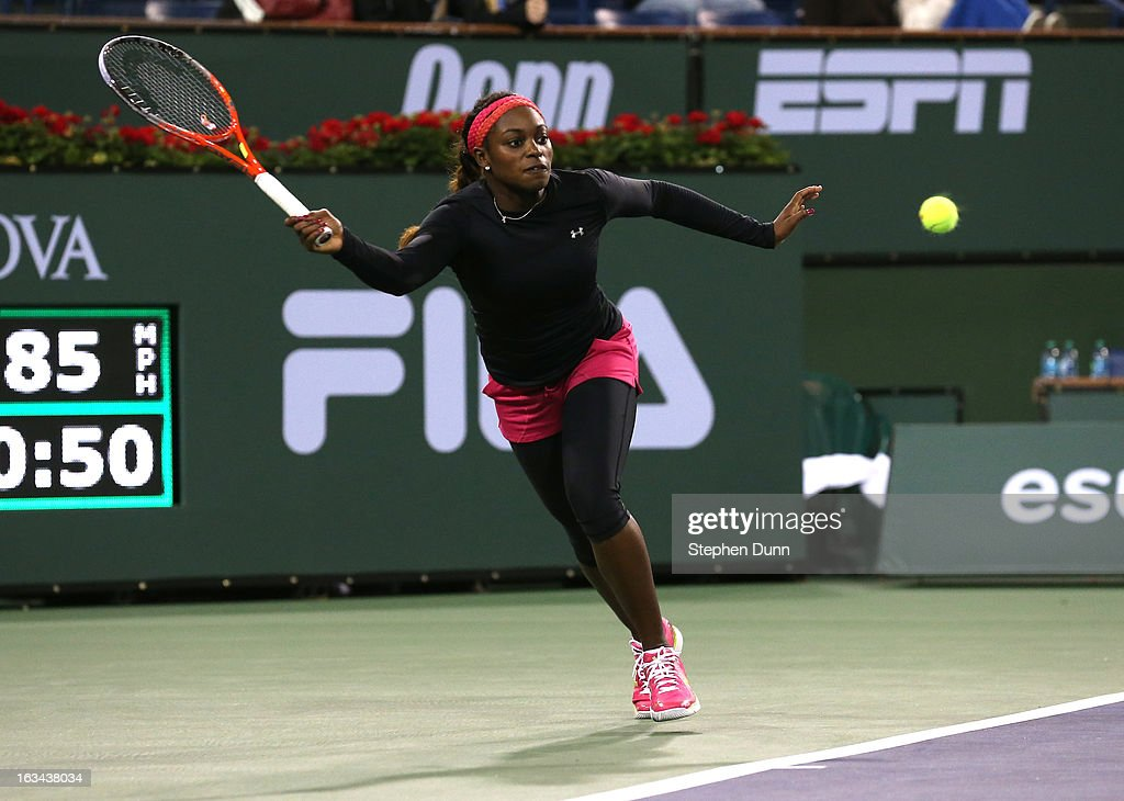 Sloane Stephens hits a return to Urszula Radwanska of Poland during day 4 of the BNP Paribas Open at Indian Wells Tennis Garden on March 9, 2013 in Indian Wells, California.