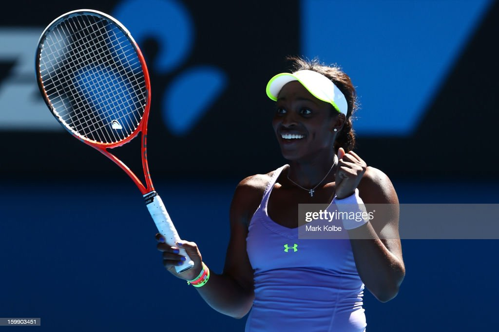 Sloane Stephens of the United States celebrates winning her Quarterfinal match against Serena Williams of the United States during day ten of the 2013 Australian Open at Melbourne Park on January 23, 2013 in Melbourne, Australia.