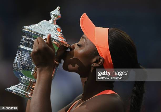 Sloane Stephens of the United States kisses the championship trophy during the trophy presentation after the Women's Singles finals match on Day...