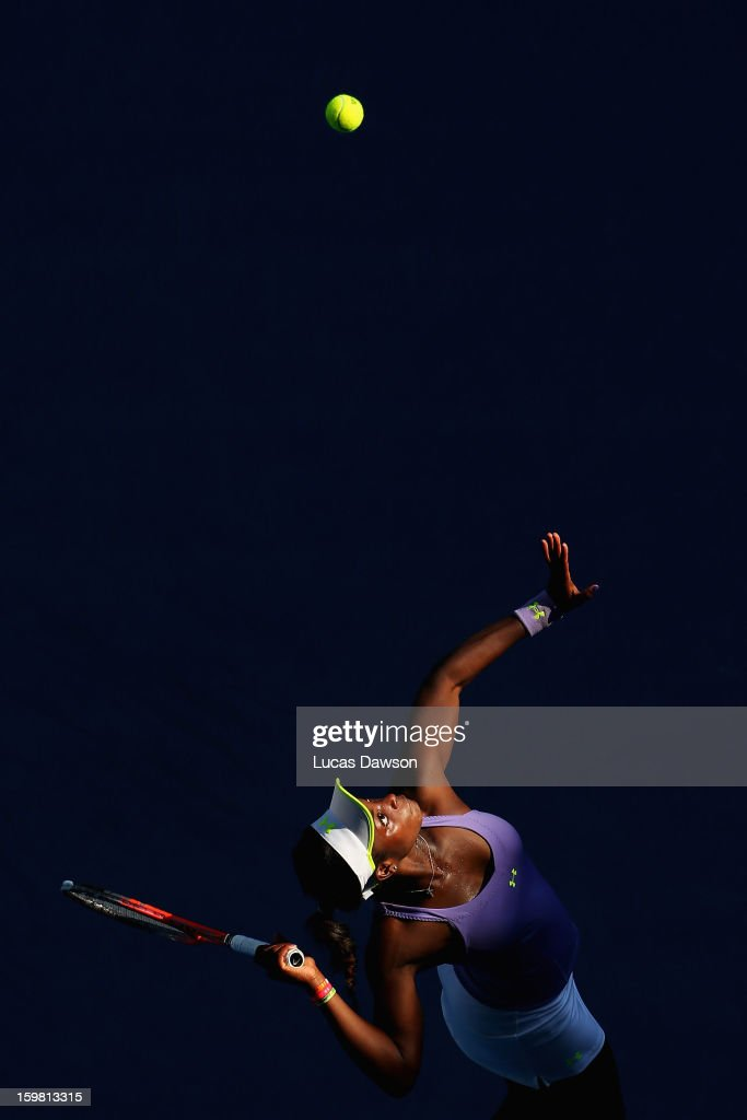 <a gi-track='captionPersonalityLinkClicked' href=/galleries/search?phrase=Sloane+Stephens&family=editorial&specificpeople=5510187 ng-click='$event.stopPropagation()'>Sloane Stephens</a> of the United States of America serves in her fourth round match against Bojana Jovanovski of Serbia during day eight of the 2013 Australian Open at Melbourne Park on January 21, 2013 in Melbourne, Australia.