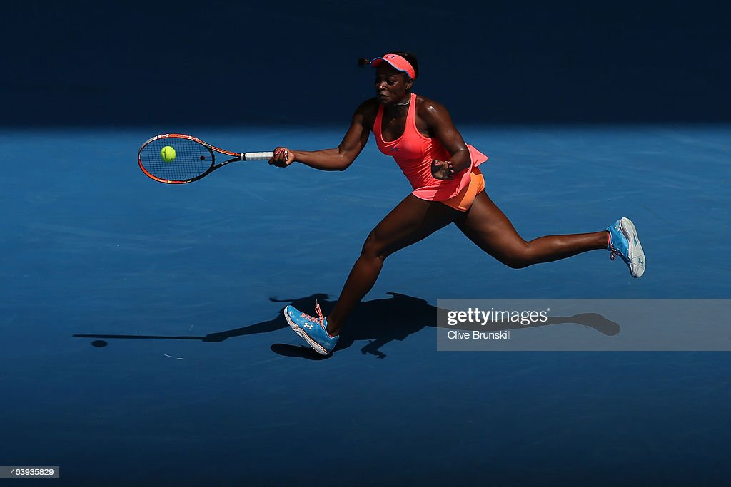 Sloane Stephens of the United States plays a forehand in her fourth round match against Victoria Azarenka of Belarus during day eight of the 2014 Australian Open at Melbourne Park on January 20, 2014 in Melbourne, Australia.