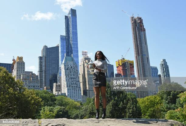 TOPSHOT Sloane Stephens of the United States poses with her championship trophy in Central Park in New York on September 10 the morning after...