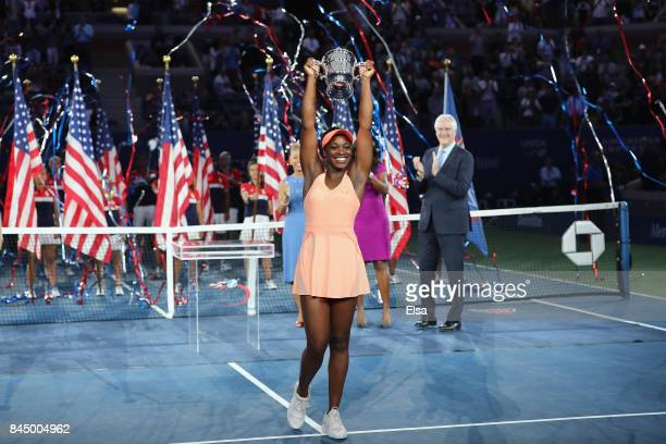 Sloane Stephens of the United States poses with the championship trophy during the trophy presentation after the Women's Singles finals match on Day...