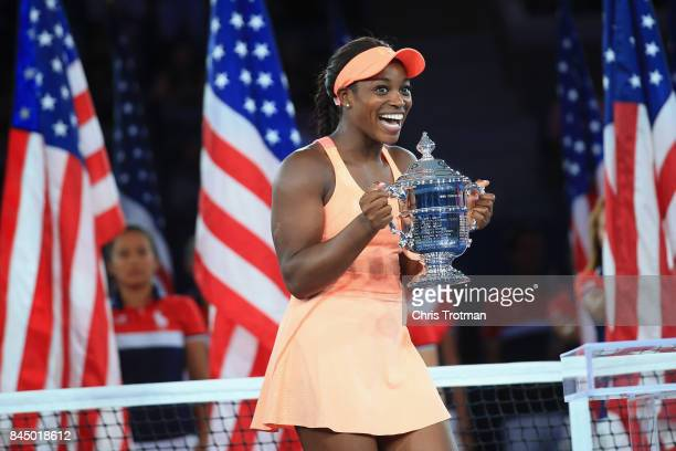 Sloane Stephens of the United States poses with the championship trophy during the trophy presentation after defeating Madison Keys of the United...