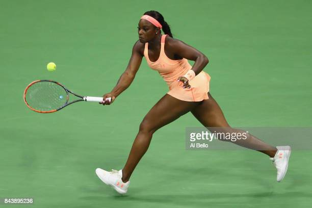 Sloane Stephens of the United States returns a shot against Venus Williams of the United States during their Women's Singles Semifinal match on Day...