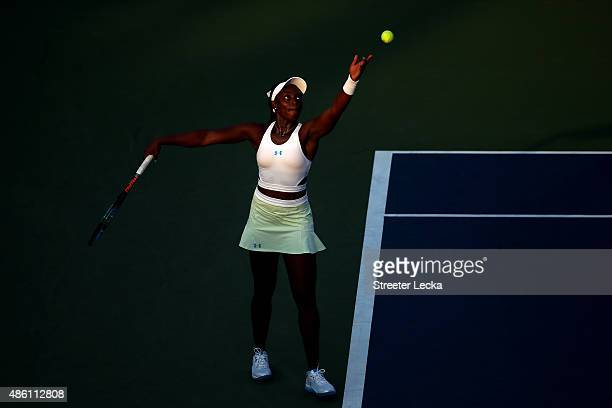 Sloane Stephens of the United States serves against Coco Vandeweghe of the United States in their Women's Singles First Round match on Day One of the...