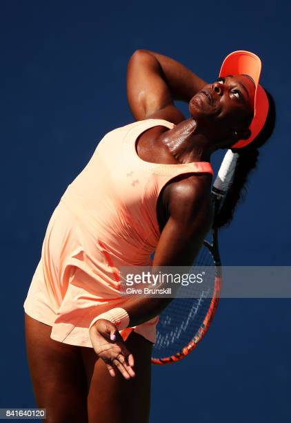 Sloane Stephens of the United States serves during her third round match against Ashleigh Barty of Australia on Day Five of the 2017 US Open at the...