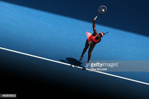 Sloane Stephens of the United States serves in her fourth round match against Victoria Azarenka of Belarus during day eight of the 2014 Australian...