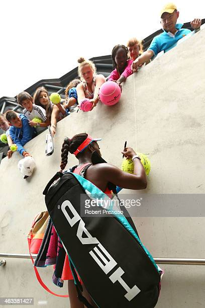 Sloane Stephens of the United States signs autographs after winning her third round match against Elina Svitolina of the Ukraine during day six of...