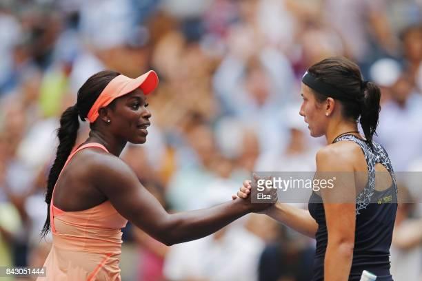Sloane Stephens of the United States speaks to Anastasija Sevastova of Latvia after defeating her during her Women's Singles Quarterfinal match on...
