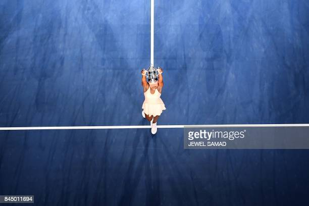 Sloane Stephens of the US poses with her winning trophy after defeating compatriot Madison Keys in their 2017 US Open Women's Singles final match at...