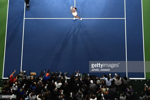 Sloane Stephens of the US poses with her winning trophy after defeating compatriot Madison Keys during their 2017 US Open Women's Singles final match...