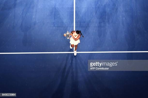 TOPSHOT Sloane Stephens of the US poses with her winning trophy after defeating compatriot Madison Keys during their 2017 US Open Women's Singles...