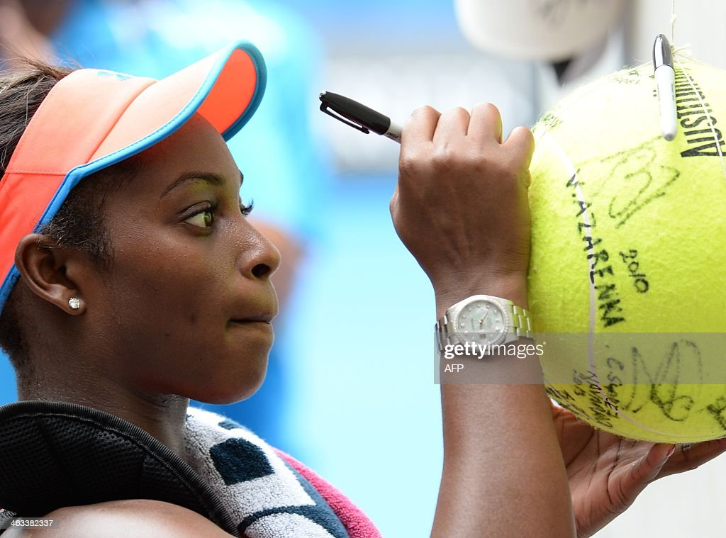 Sloane Stephens of the US signs an autograph following her win over Elina Svitolina of Ukraine in their women's singles match on day six of the 2014 Australian Open tennis tournament in Melbourne on January 18, 2014. IMAGE