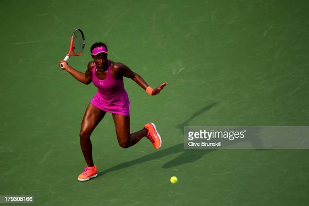 Sloane Stephens of United States returns a shot during her women's singles fourth round match against Serena Williams of the United States on Day...