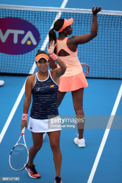 Sloane Stephens of USA and Heather Watson of Great Britain celebrate after their match against Anastasija Sevastova of Latvia and Donna Vekic of...