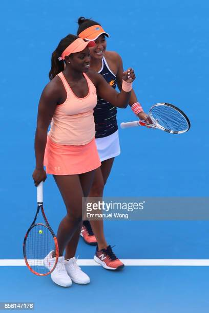 Sloane Stephens of USA and Heather Watson of Great Britain react during their match against Anastasija Sevastova of Latvia and Donna Vekic of Croatia...