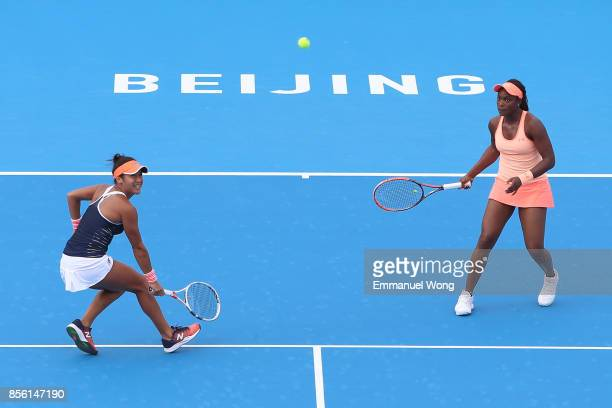 Sloane Stephens of USA and Heather Watson of Great Britain return a shot against Anastasija Sevastova of Latvia and Donna Vekic of Croatia on day two...