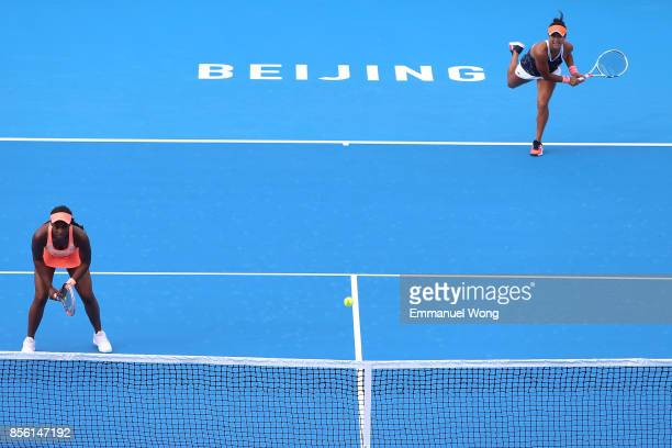 Sloane Stephens of USA and Heather Watson of Great Britain serve against Anastasija Sevastova of Latvia and Donna Vekic of Croatia on day two of the...
