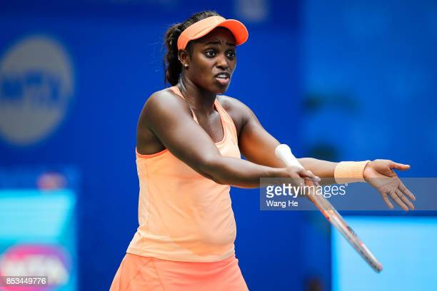 Sloane Stephens of USA reacts during the match against Qiang Wang of China Day 2 of 2017 Dongfeng Motor Wuhan Open at Optics Valley International...