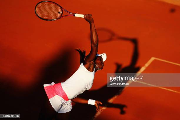 Sloane Stephens of USA serves in her women's singles fourth round match against Samantha Stosur of Australia during day 8 of the French Open at...