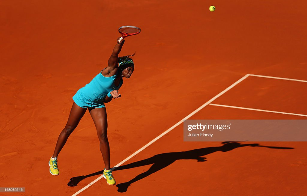 <a gi-track='captionPersonalityLinkClicked' href=/galleries/search?phrase=Sloane+Stephens&family=editorial&specificpeople=5510187 ng-click='$event.stopPropagation()'>Sloane Stephens</a> of USA serves to Daniela Hantuchova of Slovakia during the Mutua Madrid Open tennis tournament at the Caja Magica on May 4, 2013 in Madrid, Spain.