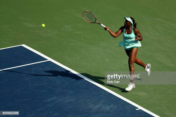 Sloane Stephens returns a shot to Simona Halep of Romania during Day 8 of the Western and Southern Open at the Linder Family Tennis Center on August...