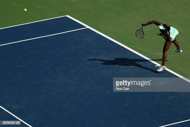 Sloane Stephens serves to Simona Halep of Romania during Day 8 of the Western and Southern Open at the Linder Family Tennis Center on August 19 2017...