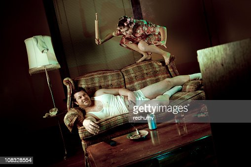 Slob Man Watching Television While Woman Pounces With