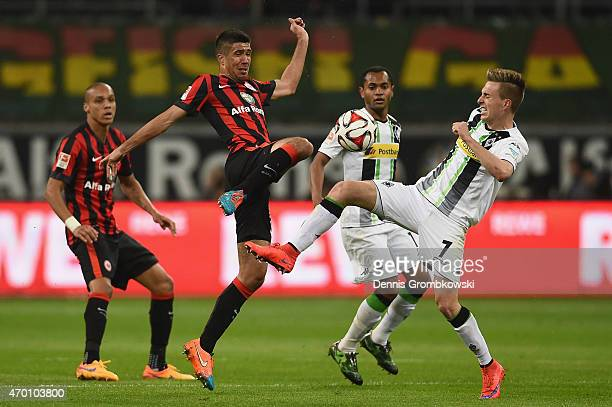 Slobodan Medojevic of Eintracht Frankfurt is challenged by Patrick Herrmann of Borussia Moenchengladbach during the Bundesliga match between...