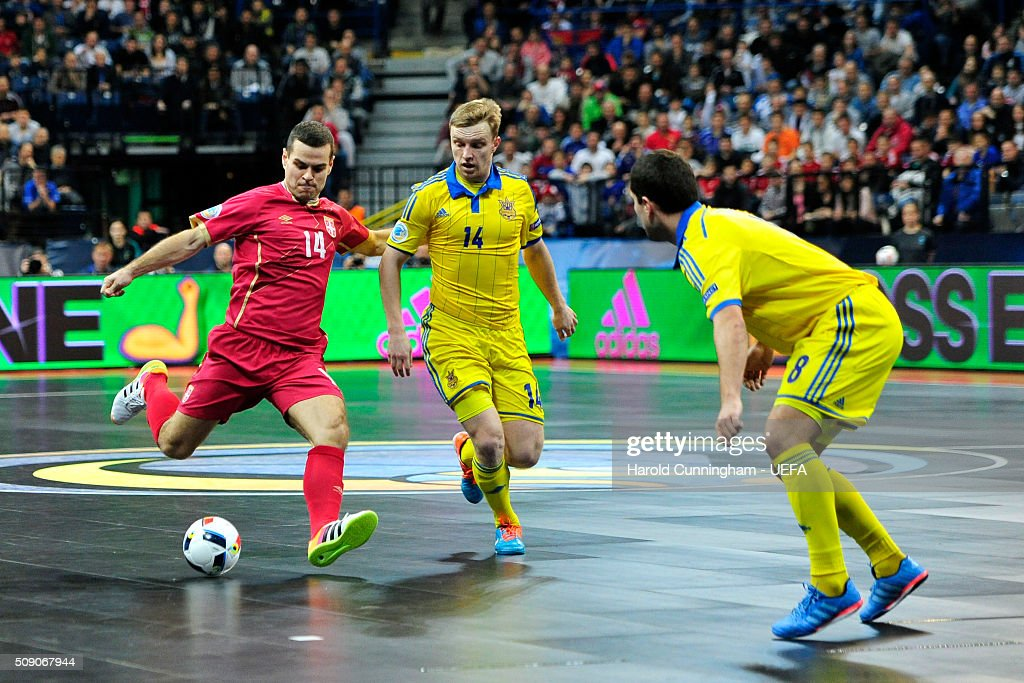 Slobodan Rajcevic of Serbia and Mykola Grytsyna of Ukraine in action during the UEFA Futsal EURO 2016 quarter final match between Serbia and Ukraine at Arena Belgrade on February 8, 2016 in Belgrade, Serbia.