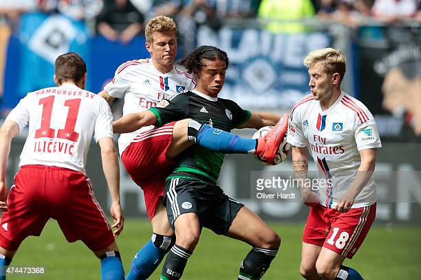 Slobodan Rajkovic of Hamburg and Leroy Sane of Schalke compete for the ball during the First Bundesliga match between Hamburger SV and FC Schalke 04...