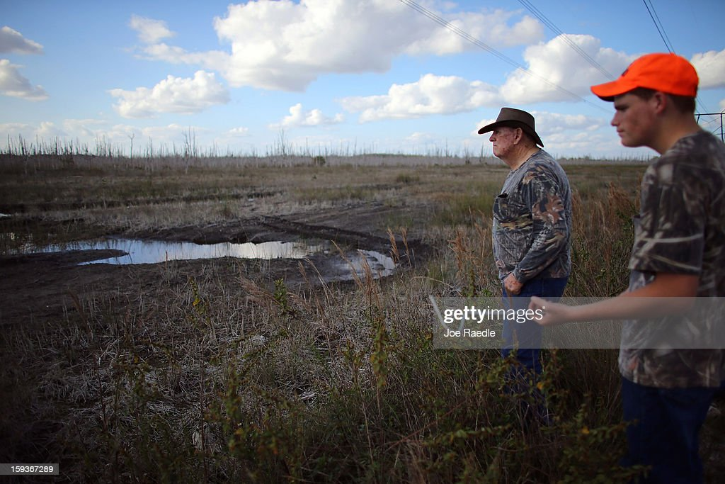 BR Slocum(L) and his grandson Kyle Storch hunt for python's in the Florida Everglades on the first day of the 2013 Python Challenge on January 12, 2013 in Miami, Florida.The Florida Fish and Wildlife Conservation Commission and its partners launched the month long 2013 Python Challenge to harvest Burmese pythons in the Florida Everglades, a species that is not native to Florida.The contest features prizes of $1,000 for catching the longest snake and $1,500 for catching the most.