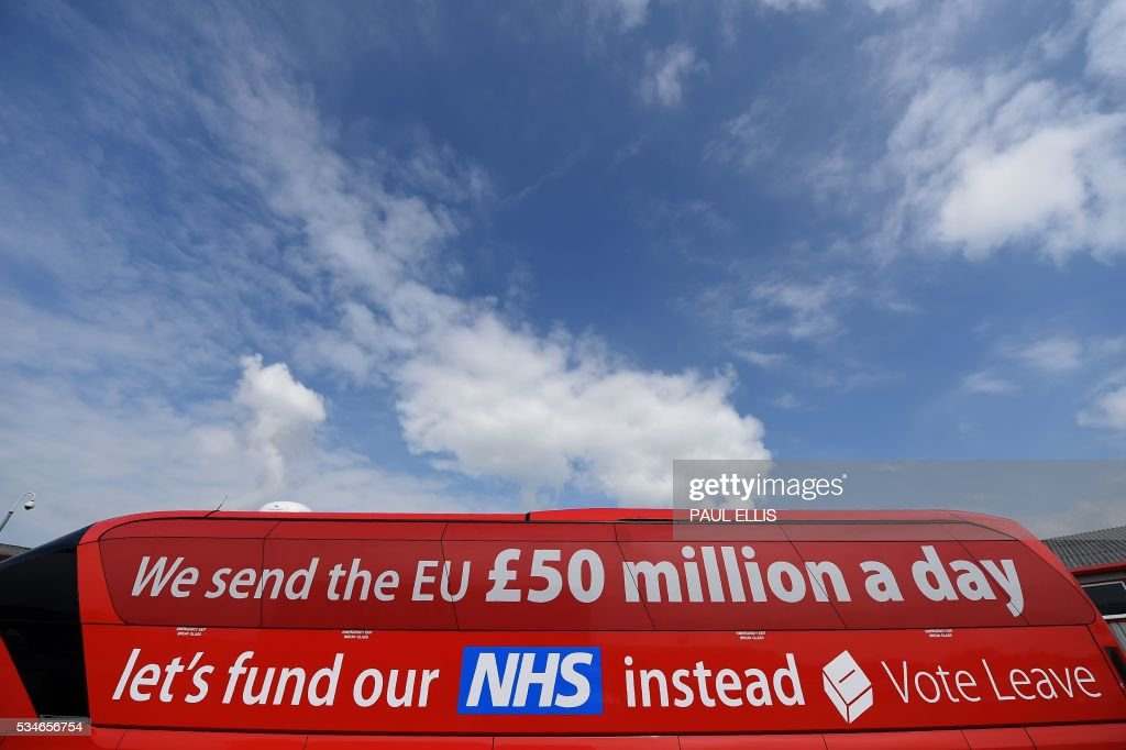The 'Vote Leave' battle-bus, the official 'Leave' campaign organisation for the forthcoming EU referendum, is pictured outside Singleton's Dairy in Preston, north-west England, on May 27, 2016. Campaigners for a 'Leave' vote in Britain's EU referendum launched an online competition and poll Friday offering £50 million for anyone who correctly predicts the outcome of every Euro 2016 fixture. The Vote Leave campaign said it had chosen the prize amount for the European football championships because it was equivalent to the sum that Britain contributes to the European Union budget every day. / AFP / PAUL