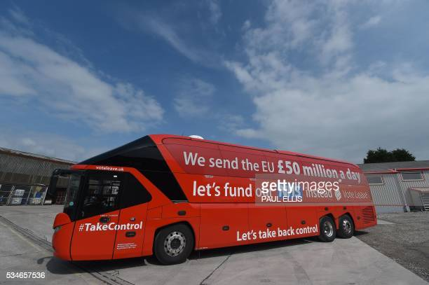 A slogan reading 'lets fund our NHS instead Vote Leave' is pictured on the side of the 'Vote Leave' battlebus the official 'Leave' campaign...