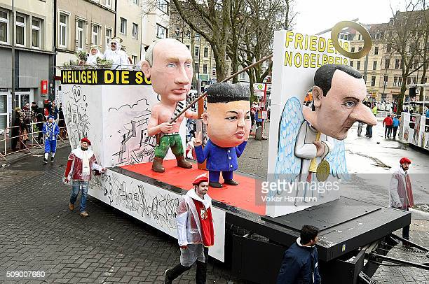 A sloganbearing float featuring Vladimir Putin Kim Jongun and Bashar alAssad makes its way through carnival revellers during the annual Rose Monday...