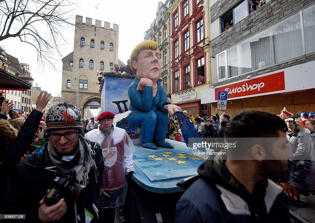 A slogan-bearing float that shows German Chancellor Angela Merkel makes its way through carnival revellers during the annual Rose Monday parade on February 8, 2016 in Cologne, Germany. The centuries-old tradition of German carnival occurs in February and runs until Ash Wednesday, the start of Lent, and culminates in Rose Monday celebrations. Police are on added alert this year, particularly in Cologne, due to the New Year`s Eve sex attacks on women that have been attributed to gangs of migrants.