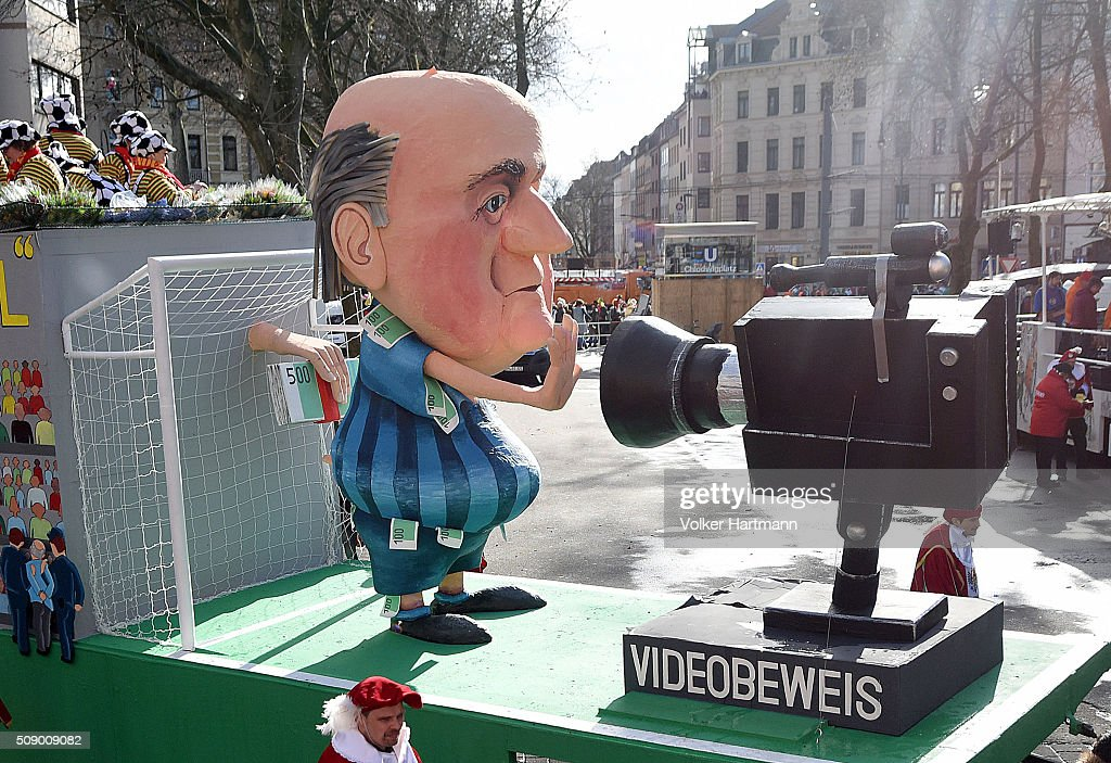 A slogan-bearing float that showsthe suspended president of FIFA, Sepp Blatter makes its way through carnival revellers during the annual Rose Monday parade on February 8, 2016 in Cologne, Germany. The centuries-old tradition of German carnival occurs in February and runs until Ash Wednesday, the start of Lent, and culminates in Rose Monday celebrations. Police are on added alert this year, particularly in Cologne, due to the New Year`s Eve sex attacks on women that have been attributed to gangs of migrants.