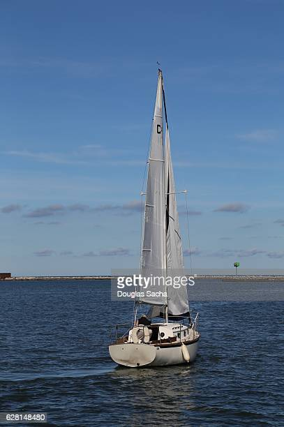 Sloop type sailing vessel heading out into the open water